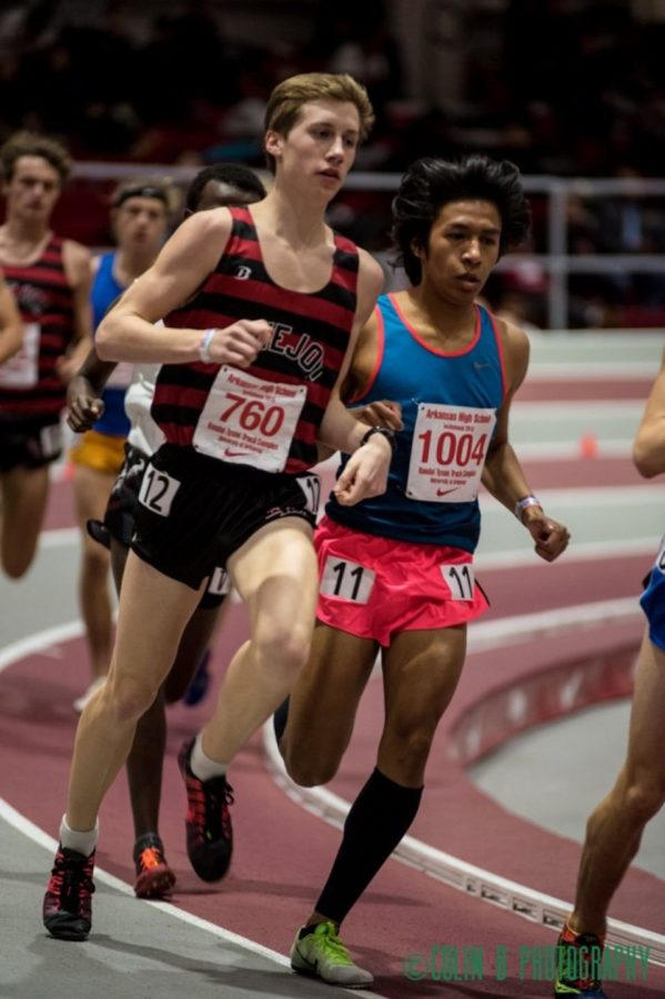 Junior Ryan Brands at the University of Arkansas indoor track last year. Both short and long distance athletes will be competing on the 200m track.