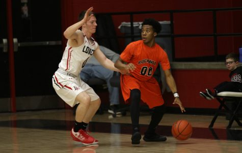 Boys basketball hopes to build momentum in second half of district