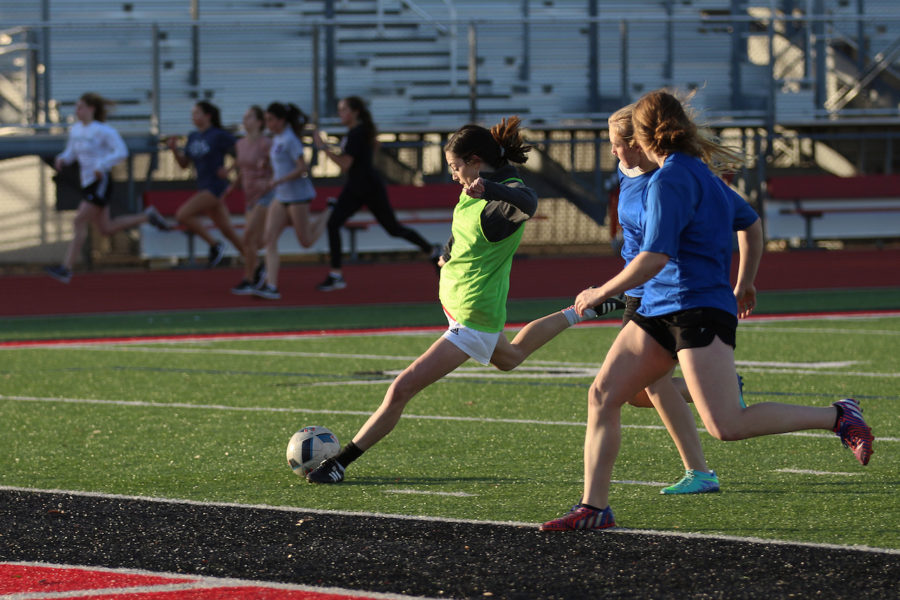 Sophomore Cassidy Lichenburg  and members of the varsity girls soccer team scrimmage after winter break.