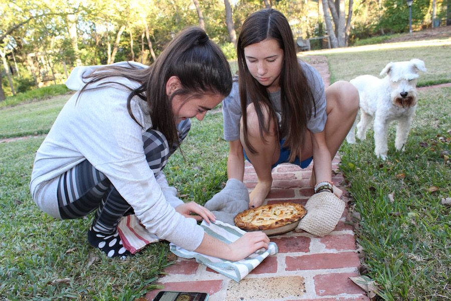One of the creators of the baking account Flour Power, Noelle Franz, and her friend Lily McCutcheon getting ready to photograph a homemade apple pie.