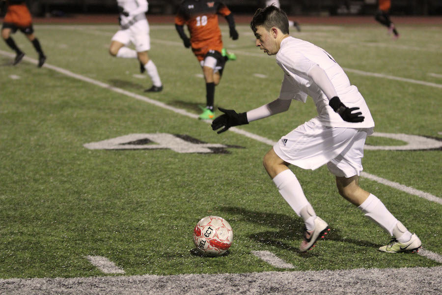 Junior Kishan Vasal dribbles down the field in the game against West Mesquite.