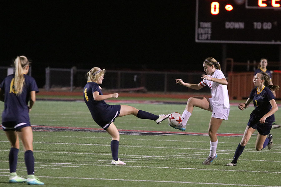 Sophomore Lizzie Weichel steals the ball from the Forney midfielder.