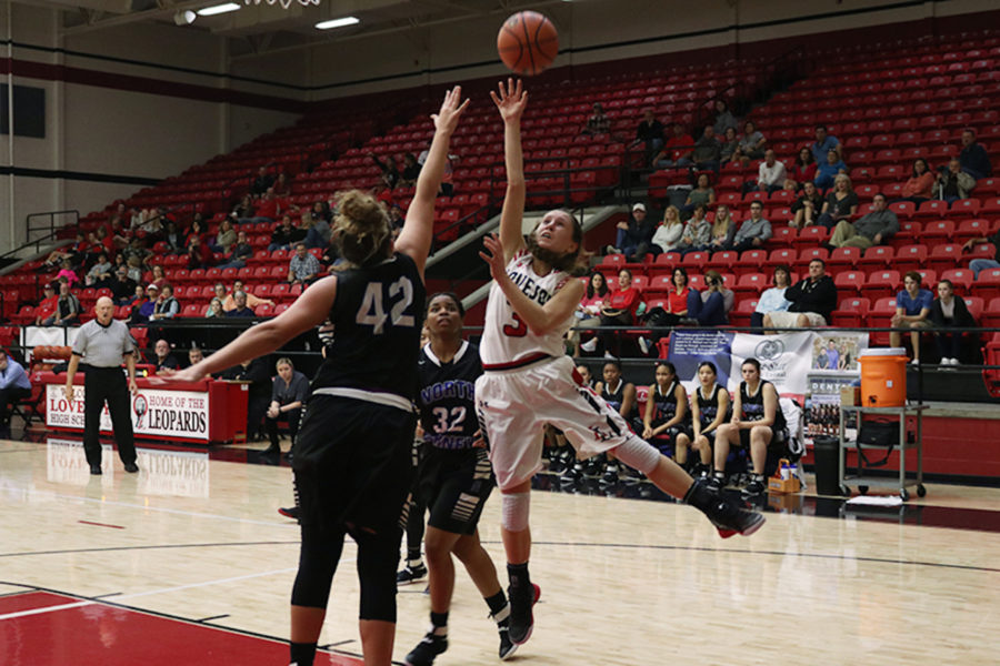 Junior Meredith Ehlmann shoots during game against North Forney.