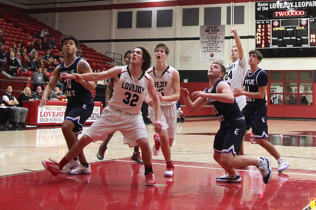 Junior Jack Supan blocking out Wylie East players from grabbing the rebound.