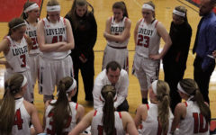 The team huddles during a timeout to prepare for the next play.