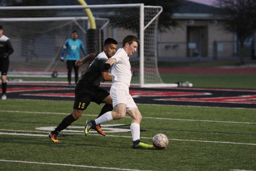 Senior Jason Bensmiller bodies the Royse City defender off the ball.