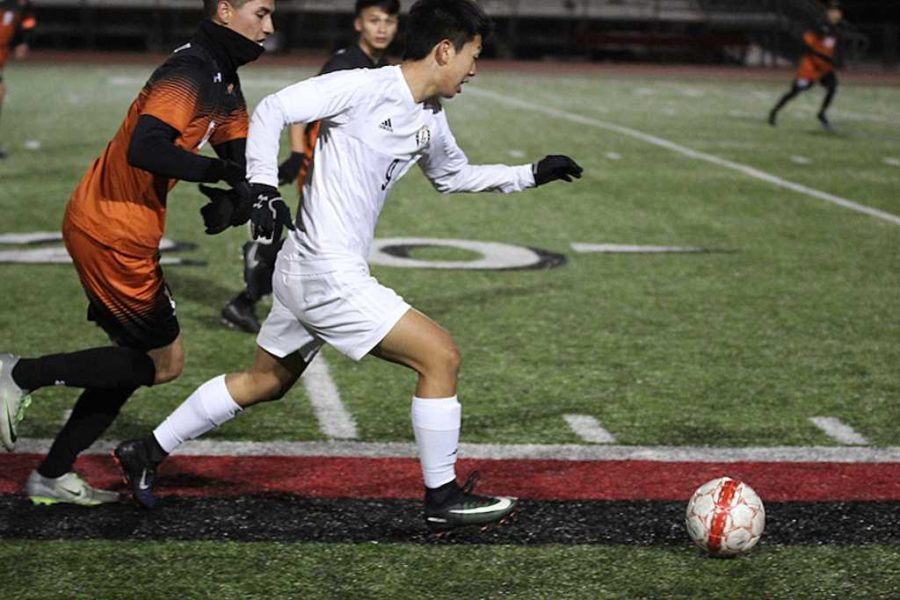 Sophomore Christian Kwon runs down field.