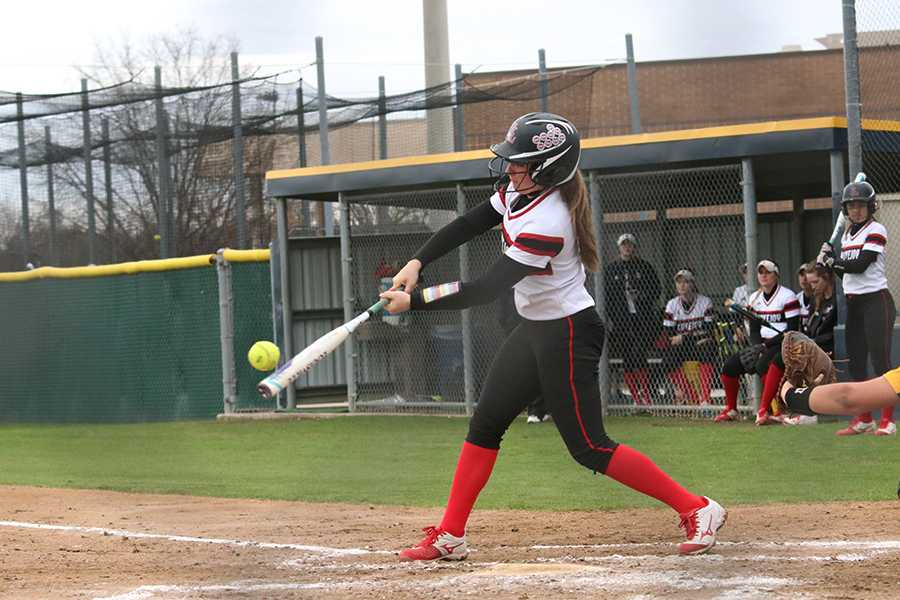The softball team will face its first district opponent away tonight at Highland Park.