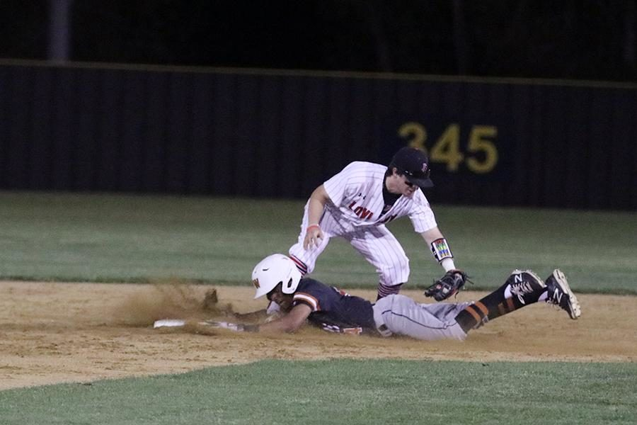 Senior Matthew Almy tagging a player at second base.