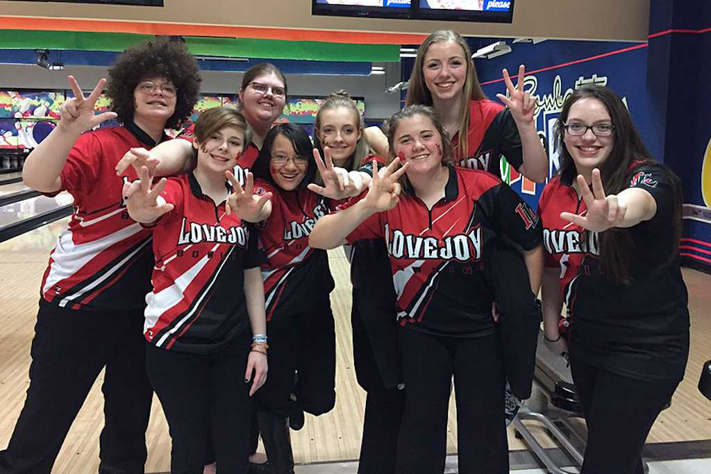 Bowling team celebrates after clinching a spot int he state tournament.