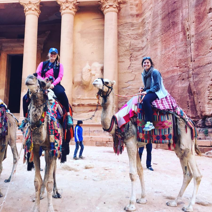 Todd and her church friend, McCarty, riding camels in Petra, Jordan.