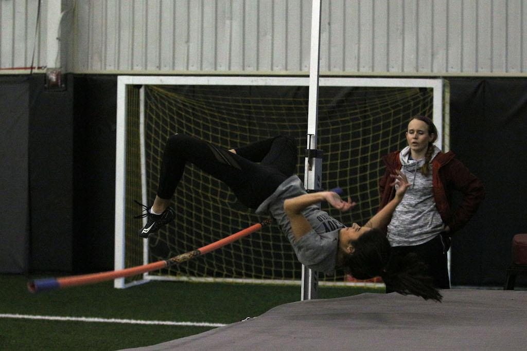 Sophomore Alaina Pierce practices high jump.