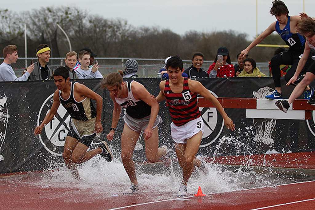 Junior Christian Sutter fighting to get out of the steeplechase pit.