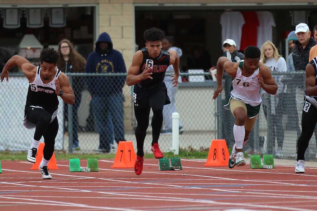 Senior Chase Van Wagoner sprints in the 100 meter event.