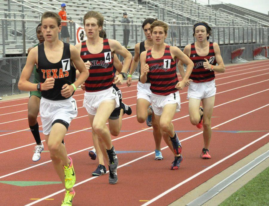 Juniors Ryan Brands, Bradley Davis ,and freshman Brady Laboret keep their pace during first event of the meet, the two mile.