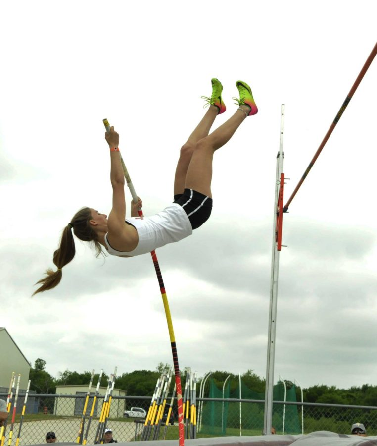 Freshman Carsen McFadden clears the height to ultimately place 5th with a height nine feet.