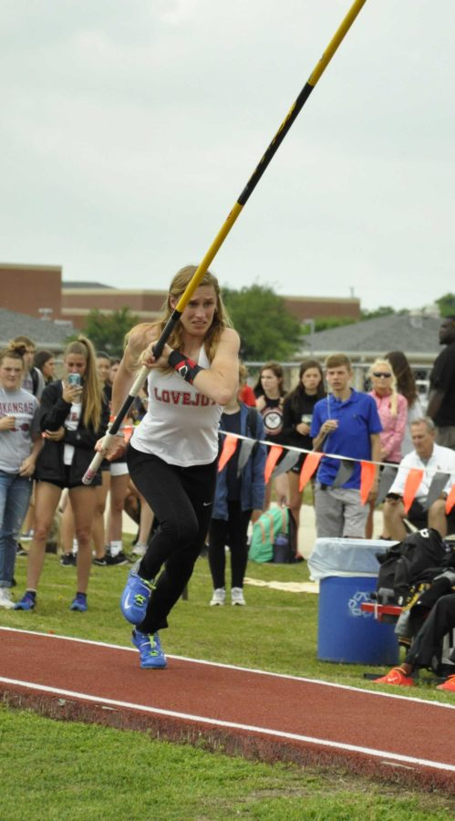 Junior Grace Ridgeway runs to the pole vault pit to execute her jump.