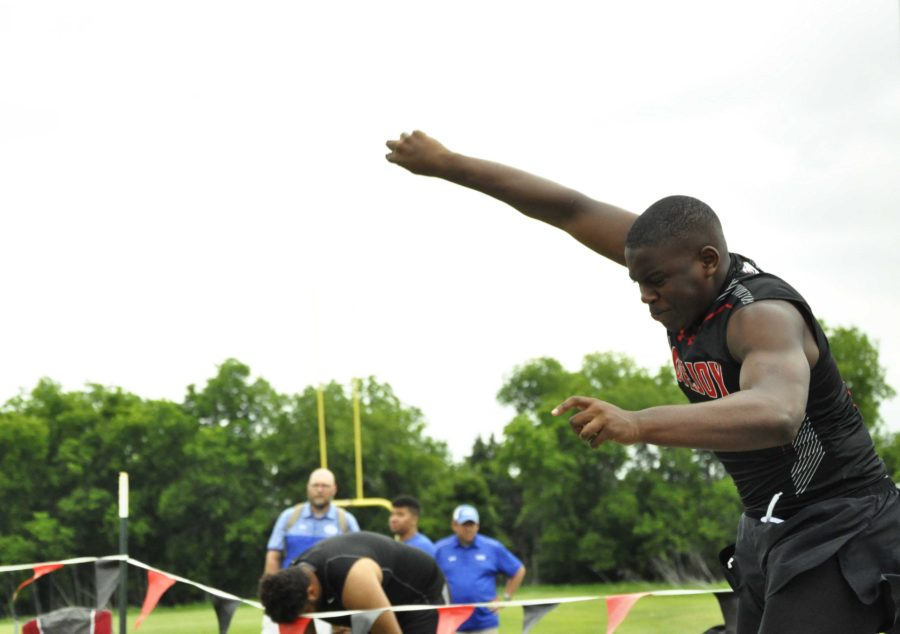 Sophomore James Rainey executes his throw to place  third and qualify for regionals.