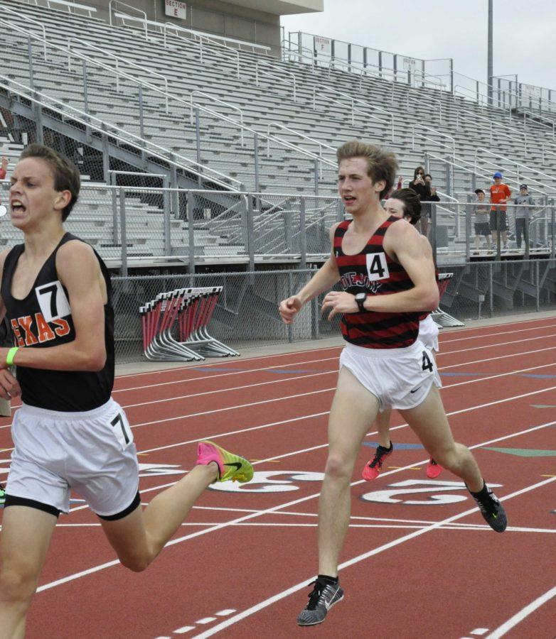 Junior Ryan Brands crosses the finish to place third in the two mile.