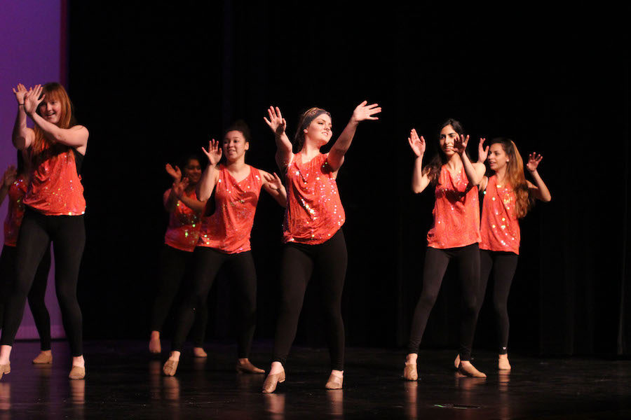 Seniors+Haley+Deschenes%2C+Lexi+Churchwell%2C+and+Amanda+Rihani+dance+in+the+finale+dance%2C+which+involves+all+students+in+the+studio+dance+program.