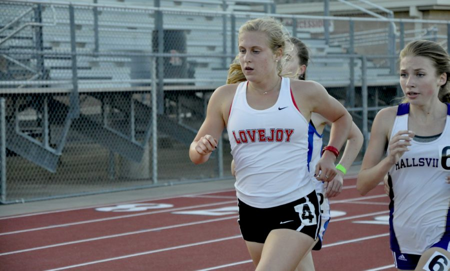 Sophomore Carson Hockersmith takes the lead to give her first place in the 1600m with a time of 5:34.