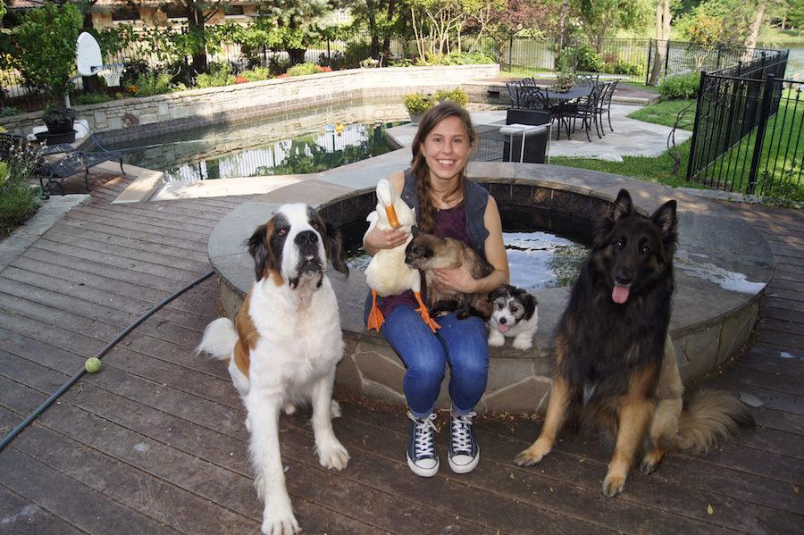 Junior Meredith Ehlmann has her hands full with the 30 animals she takes care of.