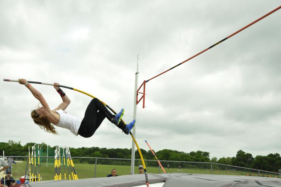 Junior Grace Ridgeway jumps 12-02.00 to place first in pole vault and tie the school record.