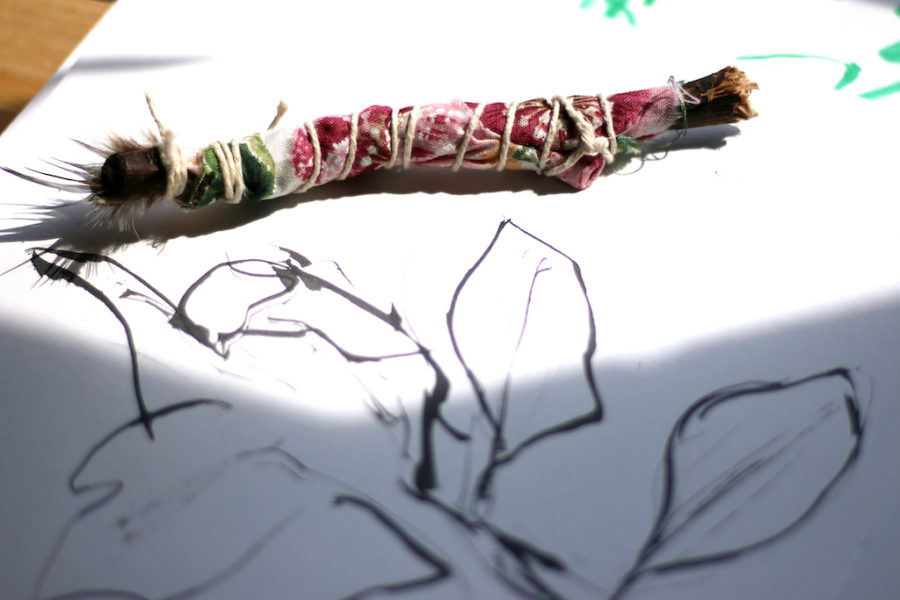 Students in first period art one crafted paintbrushes out of branches, feathers, twine and wire.