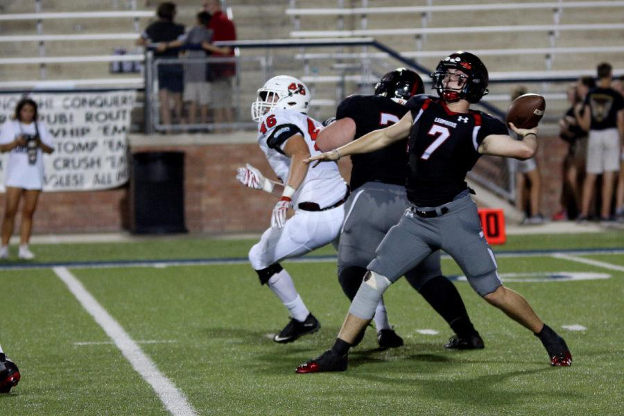 Carson Collins leans back for a deep throw against the Argyle defense. The football team relied heavily on the pass in Thursday's game, but will look to be effective with the run against Wakeland.