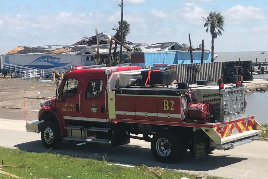 A Lucas fire truck is parked in front of a Fulton, Texas restaurant. Lucas firefighters made the journey south to assist with emergency services along the coast.
