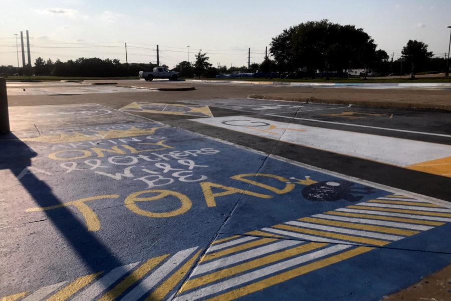 The district discontinued parking spot paintings in 2012 due to environmental impact.