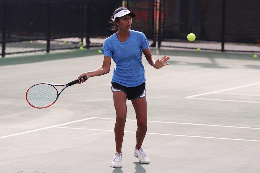 Sophomore+Sunessa+Madhav+prepares+for+a+forehand+swing.+