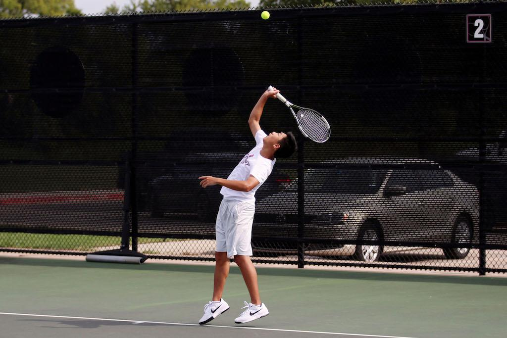 Junior Daniel Xue practices his jump serve in preparation for a matchup against Wylie East.