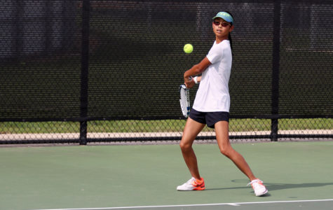 Freshman Kelly Zhang practices her backhand during practice to prepare for Forney.