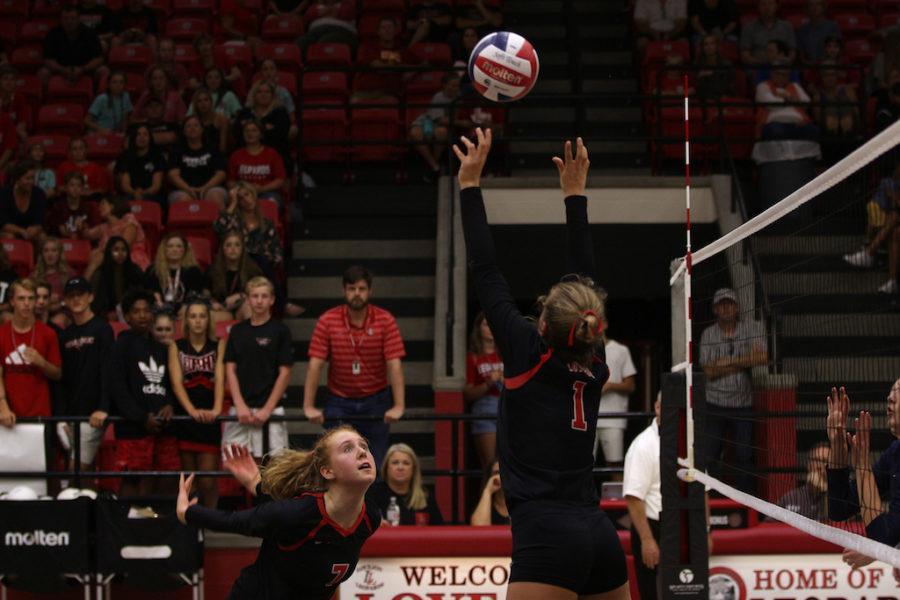 Senior+Allie+Moger+jumping+to+spike+the+ball.