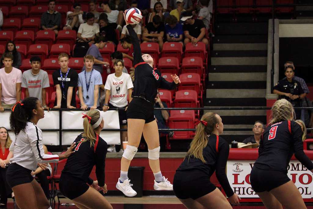 Senior Madison Waters elevates in an attempt for a kill.