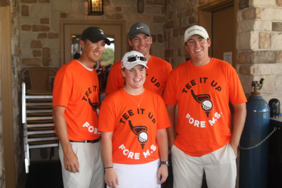 Senior Savanna Roulette stands with participants at the charity tournament