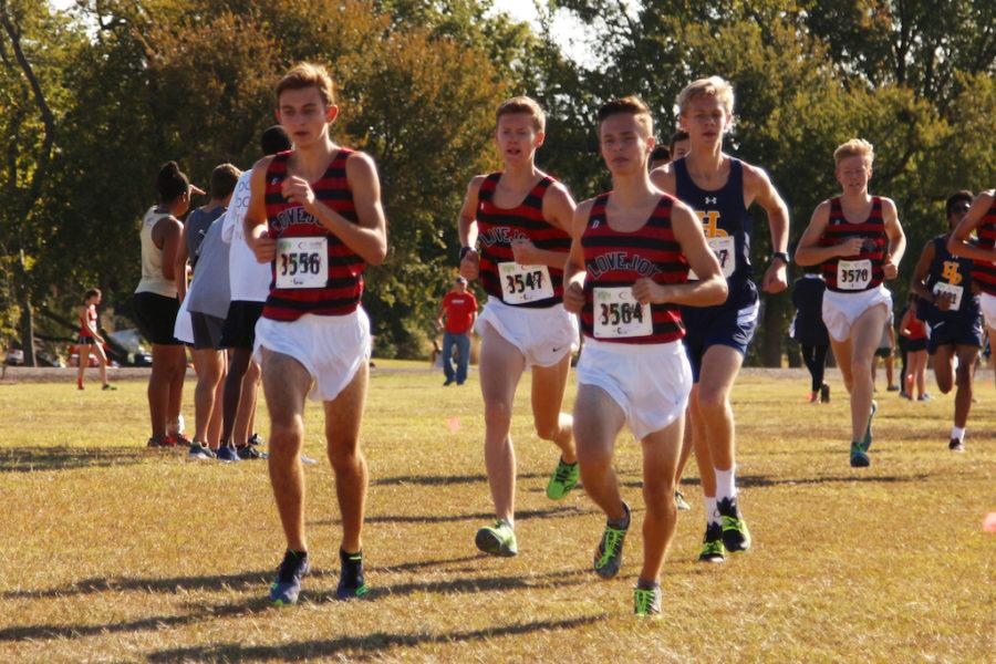 JV Boys team run for first place at district meet.