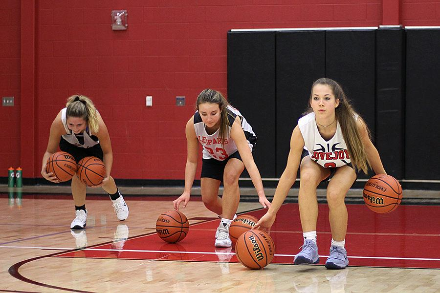 %5BFrom+left+to+right%5D+Junior+Casey+Perkins+and+sophomores+Grace+Bennett+and+Mallory+Adamson+work+on+their+dribbling+in+practice.