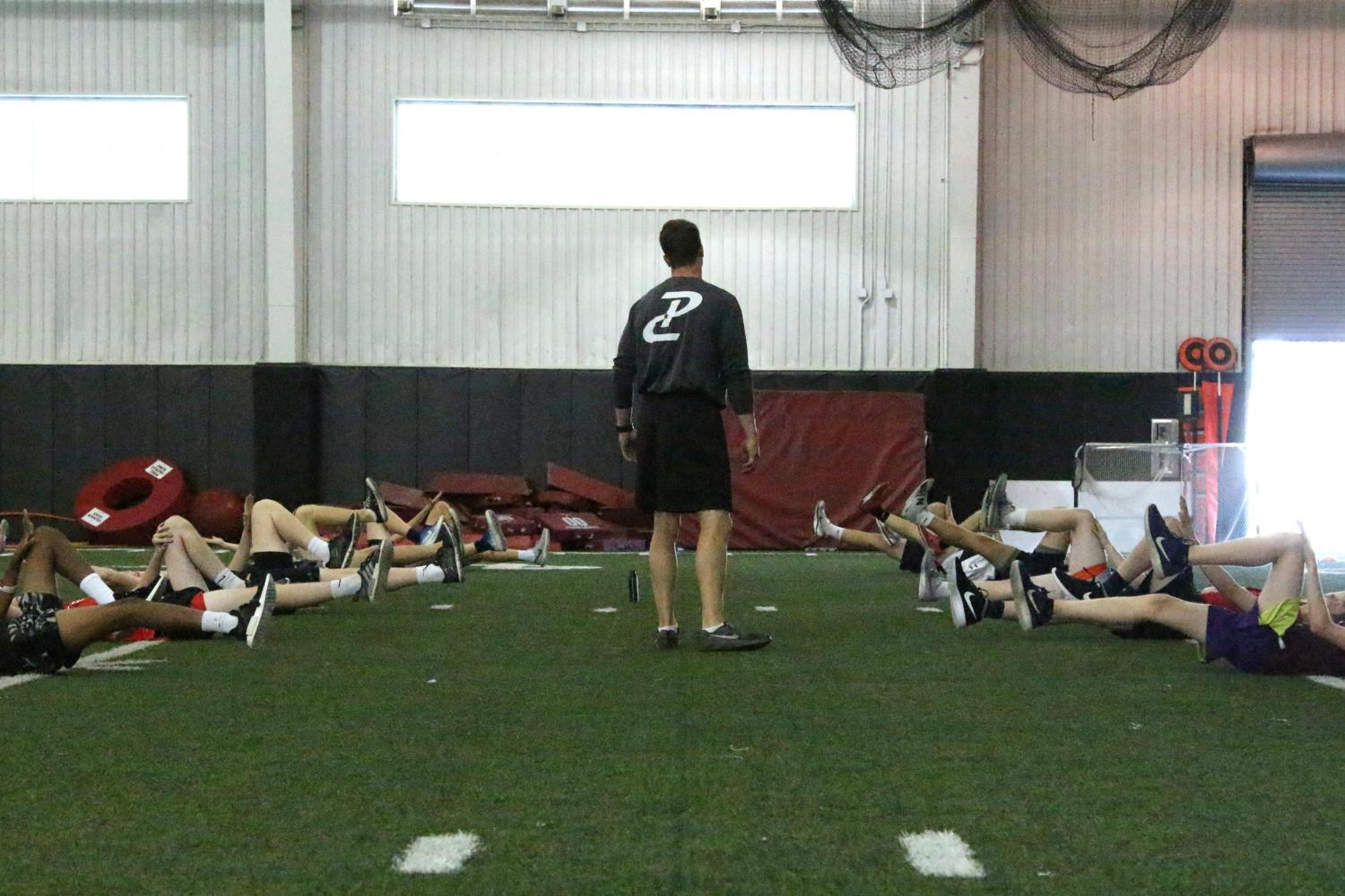 The Performance Course coaches run the athletes through core workouts.
