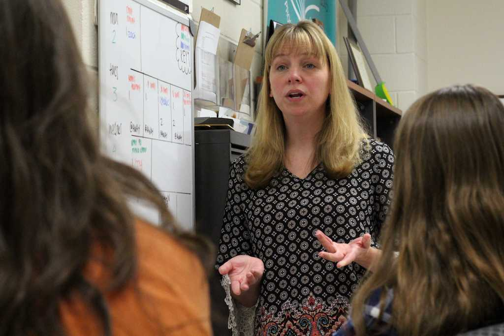 New yearbook instructor Rebecca Pollard outlines the year's deadlines with her editors.