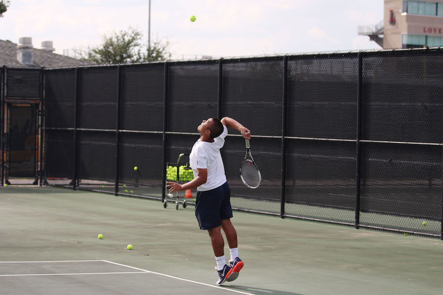 Senior Christopher Sun jumps for a serve.