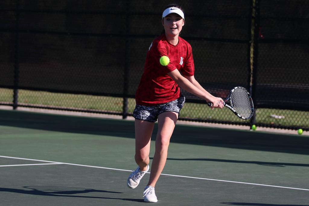 Senior Daniela Bengino returns a serve.
