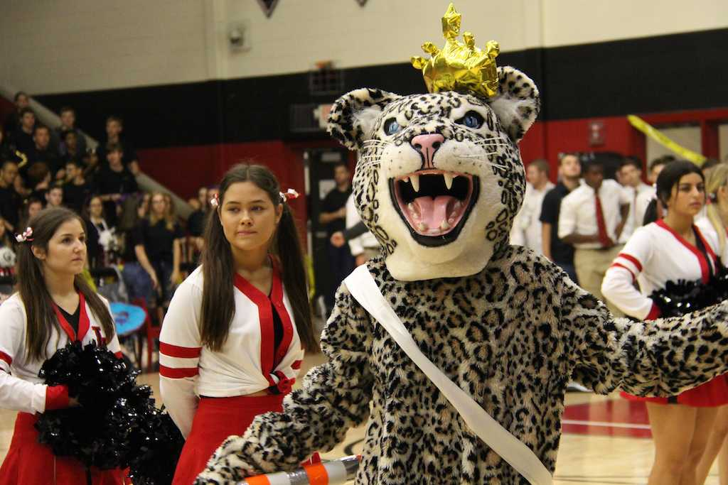 Bella entertains as Leo the Leopard at the homecoming pep rally.
