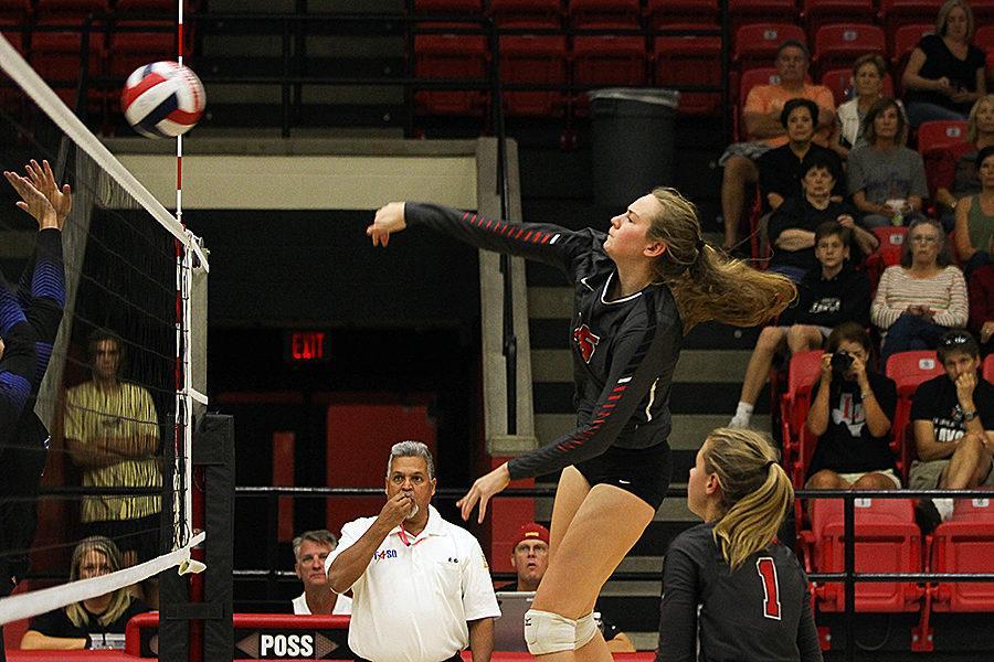 Senior+Rachel+Langs+strikes+the+ball+at+the+North+Forney+blocker.