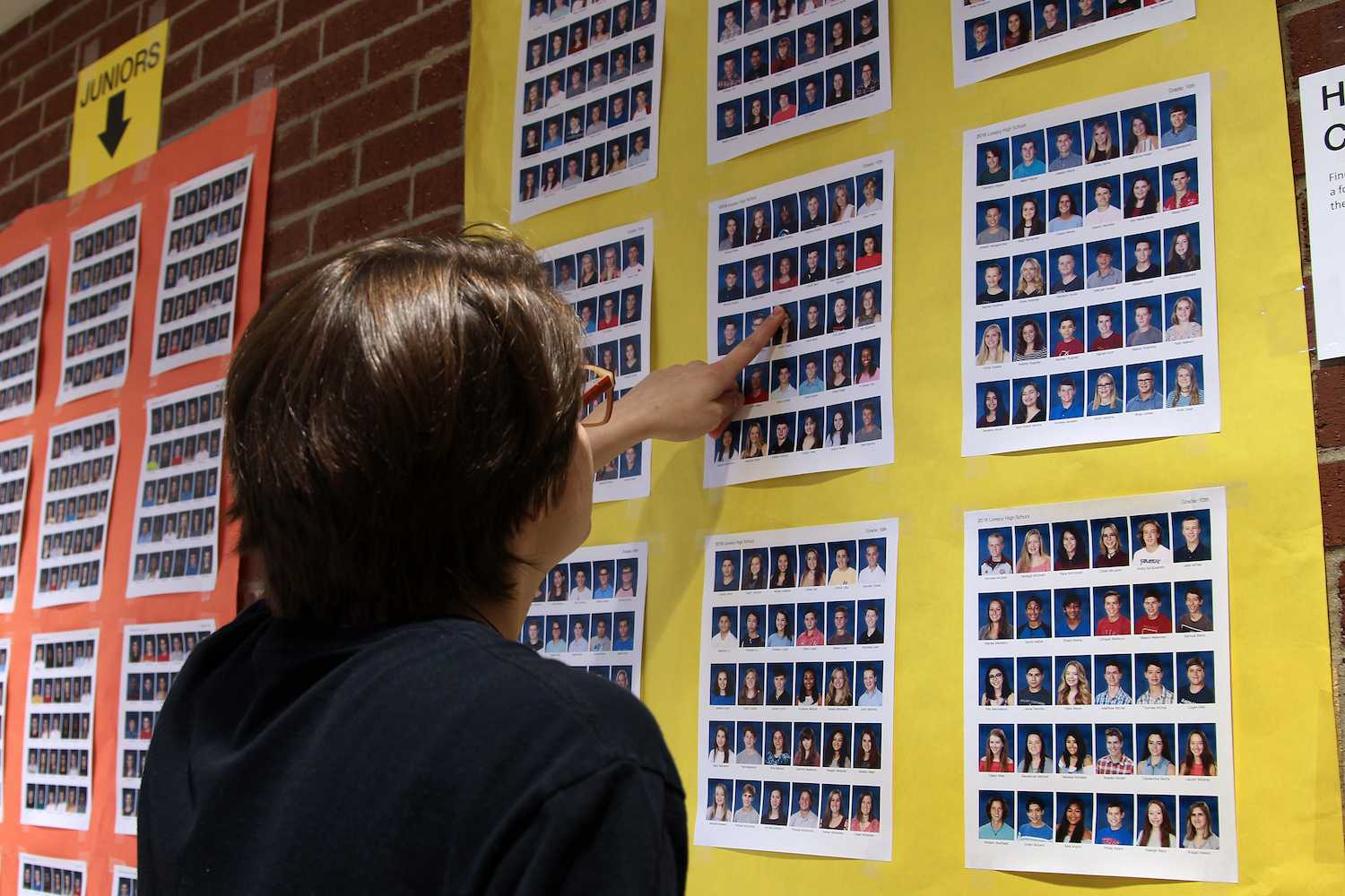 Yearbook photos are displayed in the commons to check for accuracy.