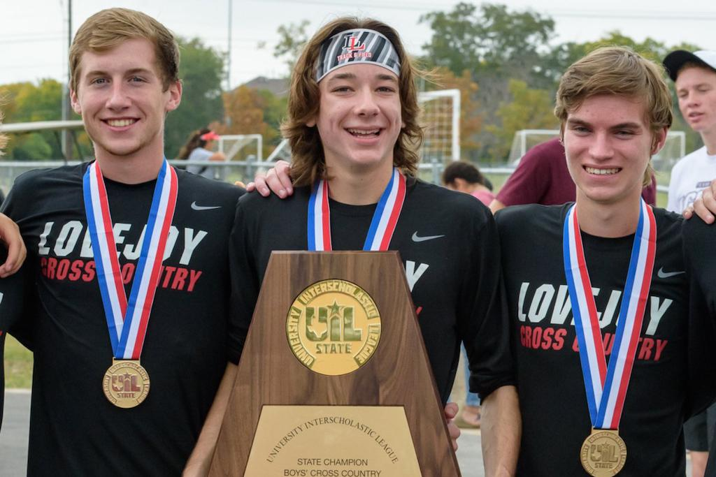 Seniors Ryan Brands, Bradley Davis, and Ryan Spruell pose with their state medals and title.
