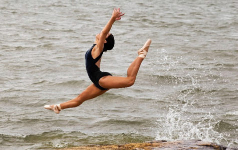 Ashton Franquiz jumps above crashing waters in her performance attire.