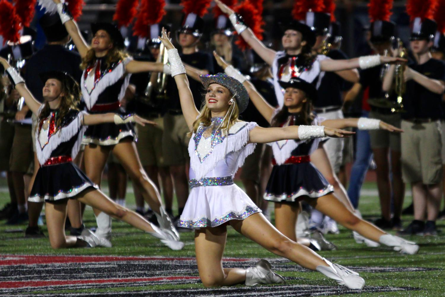 Senior Majestic Major Alyssa Whitmore performs during halftime of the home football game versus Royce City.