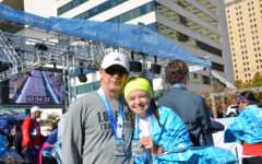 Junior Evie McGowan and her father, Barry McGowan, pose for a picture with their medals from the BMW Dallas Half Marathon.